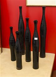 Sale 8205 - Lot 17 - A group of black glass bottles of various heights, six total, tallest H 60cm