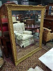 Sale 8657 - Lot 1055 - Large Antique Style Gilt Gesso Framed Mirror, with leaf scroll border & baroque style corner elements