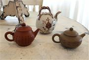Sale 8858H - Lot 30 - Antique Teapot (Origin Nanjing, China) with Two Small Yixing Teapots, H 12; 7; 6 cm -
