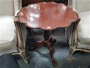 Sale 8868 - Lot 1036 - Georgian Style Mahogany Scalloped Top Occasional Table, on turned pedestal with paw feet