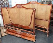Sale 8942H - Lot 32 - A French carved mahogany King size bed with tall curved ends with double caning, has rails and slats, Height approx. 160cm x Width 1...