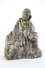 Sale 8957 - Lot 25 - A Chinese Brass Gentleman Leaning On Temple Dog H: 20cm