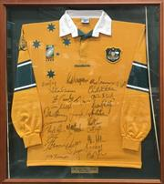 Sale 8863S - Lot 21 - 1999 World Cup Wallabies Signed Jersey, in frame