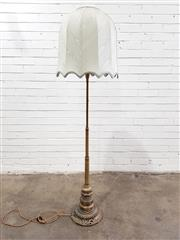 Sale 9068 - Lot 1069 - Early 20th Century Cast Brass Floor Lamp, with elaborate multi-tiered & partly pierced pedestal (h:168cm), having a cream fabric shade
