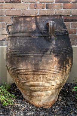 Sale 9160H - Lot 4 - A large terracotta ribbed and incised storage jar with three lug handles, Height 110cm x Diameter of top 58cm, cracked