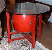 Sale 8048A - Lot 117 - A Chinese red painted occasional table with glass top and incorporating a central drum. 75 (diam)