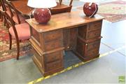 Sale 8267 - Lot 1070 - Antique Style French Walnut Knee-hole Desk, with eight drawers flanking a central door