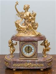 Sale 8338A - Lot 6 - A French style rouge marble and gilt metal mantle clock, surmounted with a maiden on a gondola, H 50cm x W 37cm