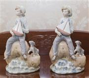 Sale 8375A - Lot 55 - A pair of Lladro figures of a boy holding sailing boat. Height 23 cm