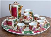Sale 8650A - Lot 33 - An Austrian porcelain cabaret coffee set with Angelica Kauffman style scenes, marked O & EG.