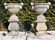 Sale 8972H - Lot 47 - Fine pair of aged composition stone urns on plinths  82cm Height 51cm Wide