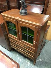Sale 8666 - Lot 1055 - French Style Carved Oak Cabinet, with two leadlight glass panel doors, three long drawers & cabriole legs (Key in Office)