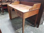 Sale 8868 - Lot 1089 - Late Georgian Mahogany Desk, with gallery back, two drawers flanking a knee-hole & tapering legs