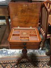 Sale 8882 - Lot 1059 - Late 19th Century Continental Figured Walnut Sewing Table, with hinged top enclosing a fitted interior, with false top drawer and pr...
