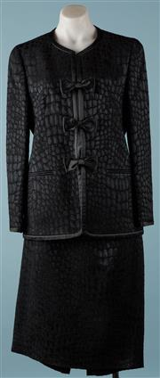 Sale 9090F - Lot 153 - A LOUIS FERAUD EVENING SUIT; black jacket and skirt, textured crocodile patterning to the fabric, 75% wool 25% silk, size US12 UK 16.