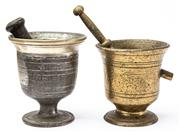Sale 9083N - Lot 66 - A near pair of graduated bronze mortar and pestles. Taller 14cm