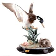 Sale 8000 - Lot 334 - A Lladro animalier group of a drake in flight and a duck, titled Patos en el estanque.
