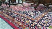 Sale 8359 - Lot 1028 - Large Persian Wool carpet, with central medallion & arabesques on a mauve field 310cm x 480cm