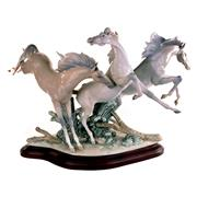 Sale 8000 - Lot 141 - A large Lladro equestrian group of three wild horses, frolicking, printed marks to base.