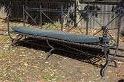 Sale 8745A - Lot 20 - An iron bench with cushion, H 92 x W 235 x D 50cm