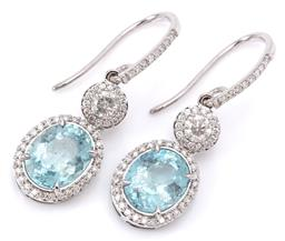 Sale 9132 - Lot 418 - A PAIR OF AQUAMARINE AND DIAMOND EARRINGS; articulated 9ct white gold drops each featuring an oval cluster centring an oval cut aqua...