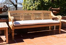Sale 9248H - Lot 294 - A large teak day bed and cushion. length 198 x depth 65 x height of back 96cm