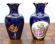 Sale 8338A - Lot 7 - Two Limoges cobalt vases, one with a colourful scene after Fragonard, H 24cm
