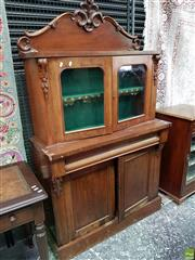 Sale 8562 - Lot 1100 - Victorian Mahogany Bookcase, probably a marriage, with carved back & two glass panel doors, with a long drawer & two timber panel do...