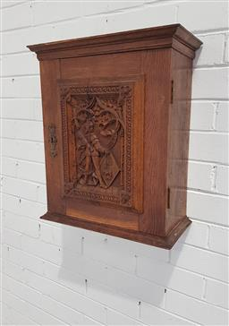 Sale 9126 - Lot 1125 - Small Late 19th/ Early 20th Century Probably German Oak Wall Cabinet, the door carved with Renaissance archer, supporting a fantasy...