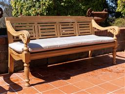 Sale 9248H - Lot 295 - A large teak day bed and cushion length 198 x depth 65 x height of back 96cm