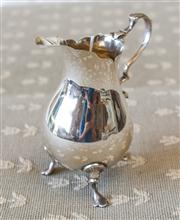 Sale 8250 - Lot 99 - A Georgian Style Sterling Silver Helmet Shaped Creamer , London 1910, Maker  modelled with a sparrows beak , waisted globular body a...