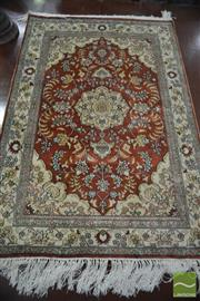 Sale 8359 - Lot 1075 - A Small Persian Silk Carpet with medallion and pendants on a russet field.