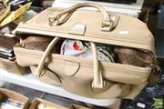 Sale 8478 - Lot 2214 - A Gucci Weekender Bag Containing a Quantity of Packaged Ladies Tights