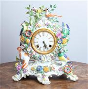 Sale 8650A - Lot 6 - A mid C20th Meissen porcelain table clock, profusely modelled with birds amongst branches and flowers, some losses, Height 31cm.
