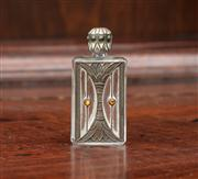 Sale 8838H - Lot 72 - A miniature glass and white metal cased perfume bottle of diminutive size