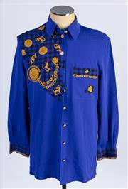 Sale 8926H - Lot 68 - A BASLER electric blue blouse with coin and rocking Horse design in gold, size 42