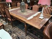 Sale 8882 - Lot 1057 - French Oak, Elm & Beech Extension Dining Table, the top & draw-leaves with burr panels & raised on cabriole legs