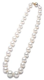 Sale 9083 - Lot 428 - A GRADUATED SOUTH SEA PEARL NECKLACE; 11 - 15.5mm round cultured pearls of silver white colour and good lustre (few spots) on a 10mm...