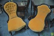 Sale 8291 - Lot 1028 - Two Victorian Carved Walnut Ladys Chairs, one with pierced supports and upholstered in yellow button velvet