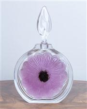 Sale 8650A - Lot 40 - A Daum crystal perfume bottle with a purple anemone flower and leaf shaped stopper, Height 21cm.