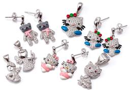 Sale 9124 - Lot 574 - THREE PAIRS OF SILVER EARRINGS AND 3 PENDANTS; incl Hello Kitty, bears and angels set with zirconias and enamel highlights, total...