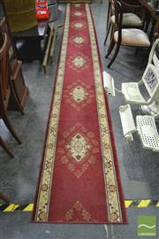 Sale 8277 - Lot 1054 - Red and Cream Tone Machine Made Rug (600 x 66cm)