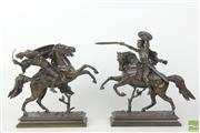 Sale 8481 - Lot 81 - Patinated bronze figural pair of horseback sword fighters.