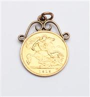 Sale 8590A - Lot 51 - A Sydney Mint 1915 half sovereign in a pendant scroll frame, marked BP, Diameter of coin 2cm