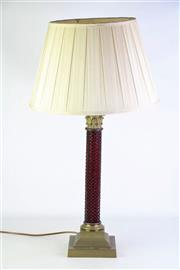 Sale 8868 - Lot 1030 - Ruby Glass & Brass Column Table Lamp, with Corinthian capital and moulded strawberry pattern column & on stepped base