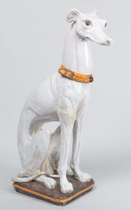 Sale 8858H - Lot 2 - Large, probably Italian ceramic Greyhound, with yellow collar & seated on cushion (some old restoration to tail area), H 125 x W 45...