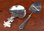 Sale 8838H - Lot 71 - A French silver plate fancy serving spoon with fruit and leaf handle marker ÍCG France' together with a cheese slicer marked 830