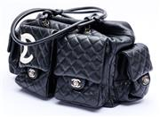 Sale 8921 - Lot 44 - A CHANEL BLACK QUILTED LEATHER LIGNE CAMBON REPORTER BAG; black quilted lambskin with white crossed Cs logo and 4 exterior pockets...