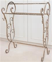 Sale 8990H - Lot 55 - A wrought iron towel rail with antique finish, Height 99cm x Width 76cm x Depth 46cm