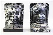 Sale 8997 - Lot 51 - Marbled Effect Composite Figural Bookends (some minor losses)